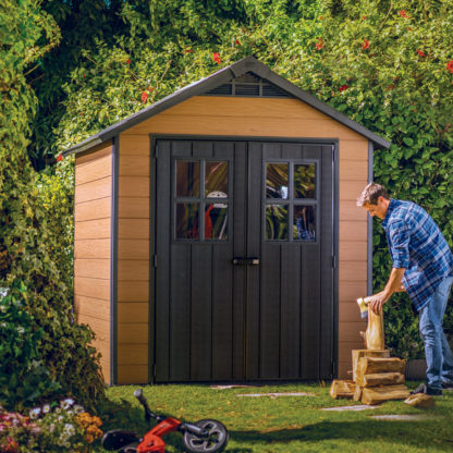 Keter Newton 757 shed in garden with man working